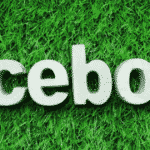 Facebook logo in white on green grass
